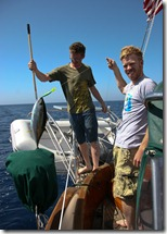 Bill and Paul Boating a Yellow Fin Tuna